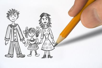 Drawing Happy family, pencil in hand closeup